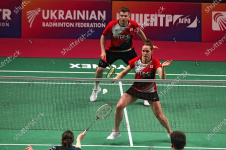 Marcus Ellis and Lauren Smith of England are seen in action with Rodion Alimov and Alina Davletova of Russia during the mixed doubles final match at the 2021 European Badminton Championships at the Palace of Sports, Kyiv, capital of Ukraine.