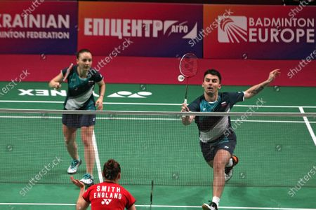 Rodion Alimov and Alina Davletova are seen in action with Marcus Ellis and Lauren Smith of England during the mixed doubles final match at the 2021 European Badminton Championships at the Palace of Sports, Kyiv, capital of Ukraine.