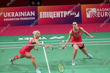 Gabriela Stoeva and Stefani Stoeva of Bulgaria compete against Chloe Birch and Lauren Smith of England during the women's doubles final match at the 2021 European Badminton Championships at the Palace of Sports, Kyiv, capital of Ukraine.