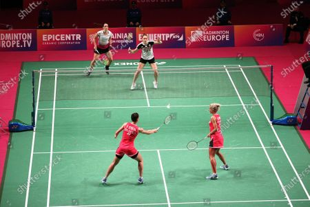 Gabriela Stoeva and Stefani Stoeva (red kit) of Bulgaria are seen in action with Chloe Birch and Lauren Smith of England during the women's doubles final match at the 2021 European Badminton Championships at the Palace of Sports, Kyiv, capital of Ukraine.