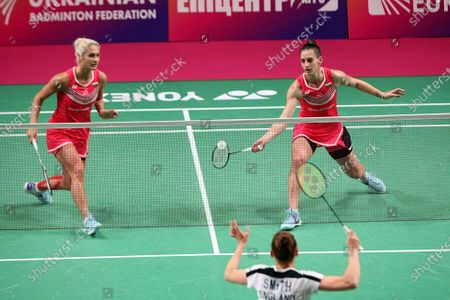 Stock Image of Gabriela Stoeva and Stefani Stoeva of Bulgaria compete against Chloe Birch and Lauren Smith of England during the women's doubles final match at the 2021 European Badminton Championships at the Palace of Sports, Kyiv, capital of Ukraine.