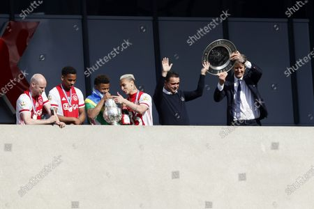 (L-R) Ajax players Davy Klaassen, Jurrien Timber, David Neres and Antony with technical director Marc Overmars and CEO Edwin van der Sar celebrate the club's 35th national championship title after winning the Dutch Eredivisie match against FC Emmen, at the Johan Cruijff Arena in Amsterdam, Netherlands, 02 May 2021.