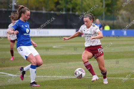 Arsenal forward Katie McCabe (15) runs at Everton defender Megan Finnigan (20) during the FA Women's Super League match between Everton Women and Arsenal Women FC at the Walton Hall Park Stadium, Liverpool