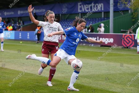 Everton defenderIngrid Wold (2) clears the danger from Arsenal forward Katie McCabe (15) during the FA Women's Super League match between Everton Women and Arsenal Women FC at the Walton Hall Park Stadium, Liverpool