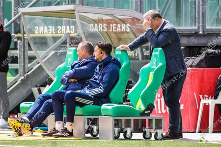 Stock Photo of (L-R) Feyenoord assistant coach John de Wolf, Feyenoord assistant coach Koen Stam and Feyenoord head coach Dick Advocaat look on during the Dutch Eredivisie match between ADO Den Haag and Feyenoord Rotterdam at the Cars Jeans stadium in The Hague, The Netherlands, 02 May 2021.