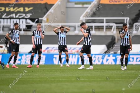 Stock Image of Newcastle players react after Fabian Schar (2-R) is given a red card during the English Premier League soccer match between Newcastle United and Arsenal FC in Newcastle, Britain, 02 May 2021.
