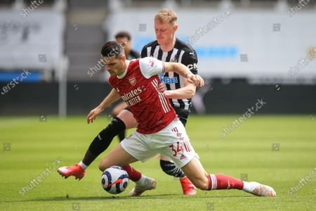 Sean Longstaff (R) of Newcastle in action against Granit Xhaka (L) of Arsenal during the English Premier League soccer match between Newcastle United and Arsenal FC in Newcastle, Britain, 02 May 2021.