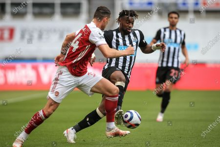 Allan Saint-Maximin (R) of Newcastle in action against Granit Xhaka (L) of Arsenal during the English Premier League soccer match between Newcastle United and Arsenal FC in Newcastle, Britain, 02 May 2021.