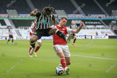 Stock Photo of Allan Saint-Maximin (L) of Newcastle in action against Granit Xhaka (R) of Arsenal during the English Premier League soccer match between Newcastle United and Arsenal FC in Newcastle, Britain, 02 May 2021.
