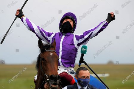 Frankie Dettori celebrates Qipco 2000 Guineas victory on Mother Earth at Newmarket.