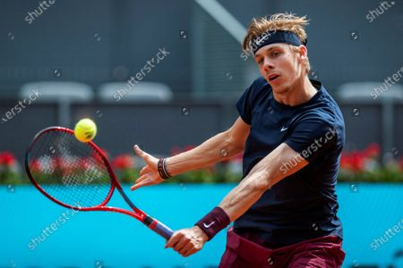 Stock Photo of Denis Shapovalov of Canada in action during his match against Dusan Lajovic of Serbia  at the Mutua Madrid Open tennis tournament, in Madrid, Spain, 02 May 2021.