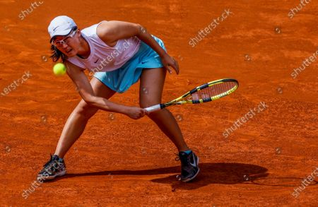 Zheng Saisai of China in action during her match against Simona Halep of Romania at the Mutua Madrid Open tennis tournament, in Madrid, Spain, 02 May 2021.