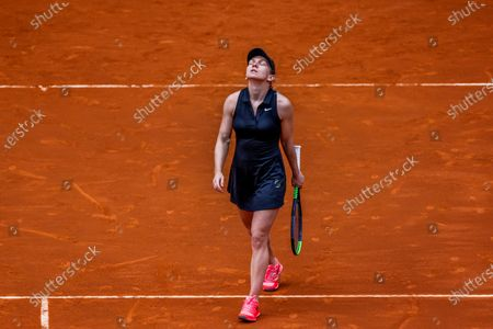 Stock Image of Simona Halep of Romania reacts during her match against Zheng Saisai of China at the Mutua Madrid Open tennis tournament, in Madrid, Spain, 02 May 2021.