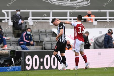 Stock Picture of Newcastle's Fabian Schaer, left, is patted on the head by his Swiss international teammate Arsenal's Granit Xhaka as he walks off the pitch after being shown a straight red card for a challenge on Arsenal's Gabriel Martinelli, not pictured, during the English Premier League soccer match between Newcastle United and Arsenal at St James' Park stadium, in Newcastle, England