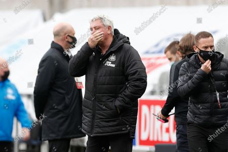 Stock Photo of Newcastle's head coach Steve Bruce reacts after the final whistle of the English Premier League soccer match between Newcastle United and Arsenal at St James' Park stadium, in Newcastle, England