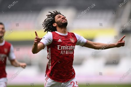 Arsenal's Mohamed Elneny celebrates scoring his side's first goal during the English Premier League soccer match between Newcastle United and Arsenal at St James' Park stadium, in Newcastle, England