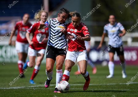 Ebony Salmon of Bristol City is challenged by Katie Zelem of Manchester United