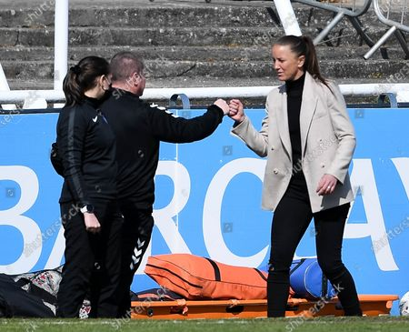 Matt Beard manager of Bristol City Women fist bumps Manchester United Women manager Casey Stoney after the final whistle of the match