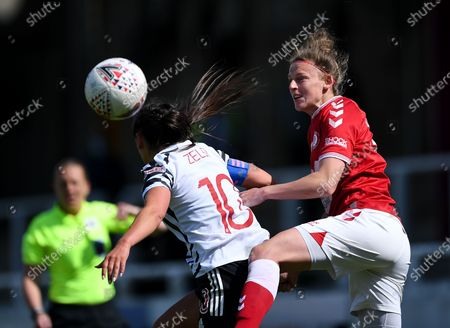 Stock Picture of Yana Daniels of Bristol City contends for the aerial ball with Katie Zelem of Manchester United