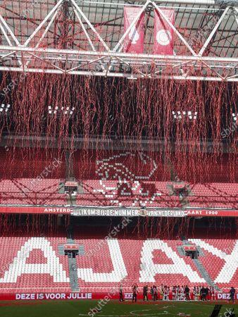 Stock Picture of Ajax goalkeeper Maarten Stekelenburg, Jurrien Timber or Ajax, Perr Schuurs or Ajax, Edson Alvarez or Ajax, Sean Klaiber or Ajax, Davy Klaassen or Ajax, David Neres or Ajax, Ryan Gravenberch or Ajax, Oussama Idrissi or Ajax, Dusan Tadic or Ajax, Noussadic Majax Raoui or Ajax, Devyne Rensch or Ajax, Ajax goalkeeper Kjell Scherpen, Daley Blind or Ajax, Jurgen Ekkelenkamp or Ajax, Zakaria Labyad or Ajax, Mohammed Kudus or Ajax, Lisandro Martinez or Ajax, Sebastien Haller or Ajax, Lassina Traore or Ajax, Kenneth Taylor or Ajax, Tagliafico or Ajax, Ajax goalkeeper Dominik Kotarski, Neraysho Kasanwirjo or Ajax, Antony Matheus Dos Santos or Ajax, Quinten Timber or Ajax, Ajax coach Erik ten Hag, Ajax assistant coach Christian Poulsen, Ajax assistant coach Michael Revelger, Ajax assistant coach Winston Bogarde, Ajax goalkeeper coach Anton Scheutjens with the Dutch Eredivisie trophy, dish hoist the banners for winning the KNVB Cup and the national team championship during the Dutch Eredivisie match between Ajax Amsterdam and FC Emmen at the Johan Cruijff Arena