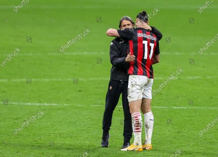Zlatan Ibrahimovic of AC Milan and Head Coach of Benevento Calcio, Filippo Inzaghi hugging during the 2020/21 Italian Serie A football match between AC Milan and Benevento Calcio at Stadio Giuseppe Meazza. Final score; AC Milan 2:0 Benevento Calcio.