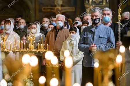 The fifth President of Ukraine Petro Poroshenko (R) during  the Easter Liturgy in the St Michael's Golden-Domed Cathedral in Kyiv, Ukraine, on May 1, 2021