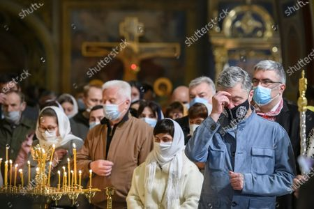 The fifth President of Ukraine Petro Poroshenko during  the Easter Liturgy in the St Michael's Golden-Domed Cathedral in Kyiv, Ukraine, on May 1, 2021