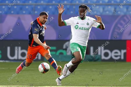 Montpellier's Keagan Dolly (L) and Saint-Etienne's Charles Nathan Abi (R) in action during the French Ligue 1 soccer match between Montpellier HSC and AS Saint-Etienne in Montpellier, France, 02 May 2021.
