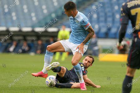 Milan Badelj (Genoa) defends on Joaquin Correa (Lazio) during the Serie A match between SS Lazio vs Genoa CFC at Stadio Olimpico on May 2, 2021 in Rome, Italy.  Lazio wins 4-3.