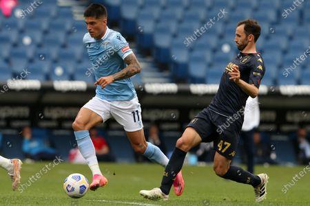 Joaquin Correa (Lazio) anticipates Milan Badelj (Genoa) during the Serie A match between SS Lazio vs Genoa CFC at Stadio Olimpico on May 2, 2021 in Rome, Italy.  Lazio wins 4-3.