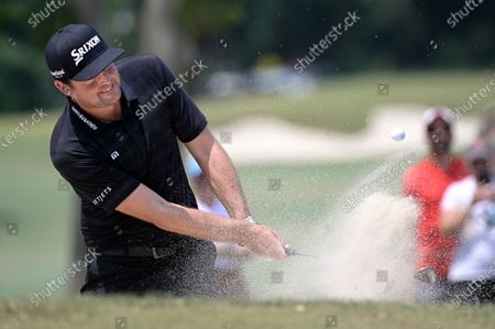 Keegan Bradley hits from a bunker onto the third green during the final round of the Valspar Championship golf tournament, in Palm Harbor, Fla