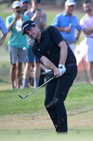 Keegan Bradley hits onto the 16th green during the final round of the Valspar Championship golf tournament, in Palm Harbor, Fla
