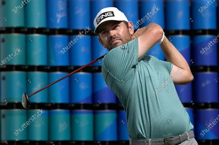 Louis Oosthuizen, of South Africa, watches his tee shot on the 18th hole during the final round of the Valspar Championship golf tournament, in Palm Harbor, Fla
