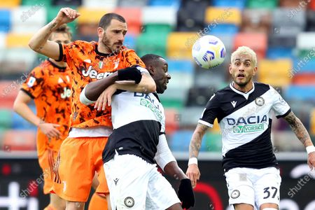 Udinese's Stefano Okaka (C) and Juventus' Leonardo Bonucci (L) in action during the Italian Serie A soccer match between Udinese Calcio and Juventus FC in Udine, Italy, 02 May 2021.