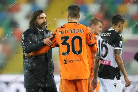 Stock Picture of Juventus' head coach Andrea Pirlo (L) and Rodrigo Bentancur (C) celebrate after winning the Italian Serie A soccer match between Udinese Calcio and Juventus FC in Udine, Italy, 02 May 2021.