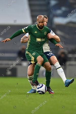 Stock Image of Sheffield United's David McGoldrick is challenged by Tottenham's Eric Dier, rear, during the English Premier League soccer match between Tottenham and Sheffield United, at the Tottenham Hotspur Stadium in London