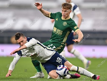Tottenham's Giovani Lo Celso (L) in action against Sheffield's Ben Osborn (R) during the English Premier League soccer match between Tottenham Hotspur and Sheffield United in London, Britain, 02 May 2021.