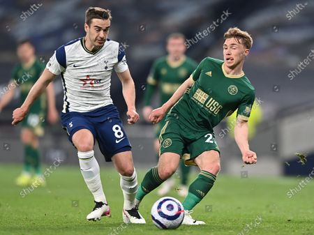 Sheffield's Ben Osborn (R) in action against Tottenham's Harry Winks (L) during the English Premier League soccer match between Tottenham Hotspur and Sheffield United in London, Britain, 02 May 2021.