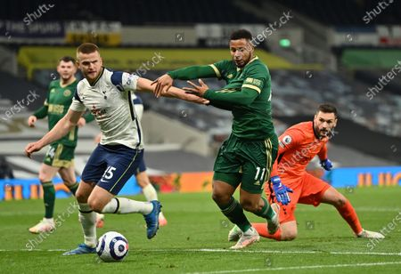 Tottenham's Eric Dier (L) in action against Sheffield's Lys Mousset (C) during the English Premier League soccer match between Tottenham Hotspur and Sheffield United in London, Britain, 02 May 2021.