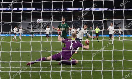 Tottenham's Gareth Bale (C-R) scores the 2-0 lead past Sheffield's goalkeeper Aaron Ramsdale (front) during the English Premier League soccer match between Tottenham Hotspur and Sheffield United in London, Britain, 02 May 2021.