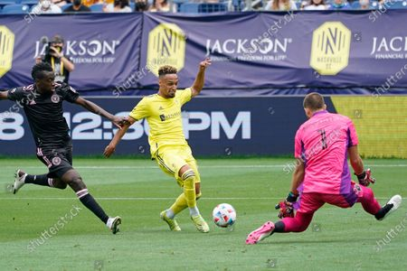 Nashville SC midfielder Hany Mukhtar, center, tries to get off a shot as he is defended by Inter Miami midfielder Blaise Matuidi, left, and goalkeeper John McCarthy (1) during the first half of an MLS soccer match, in Nashville, Tenn