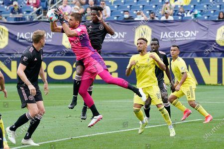 Inter Miami goalkeeper John McCarthy (1) blocks a shot during the first half of an MLS soccer match against Nashville SC, in Nashville, Tenn