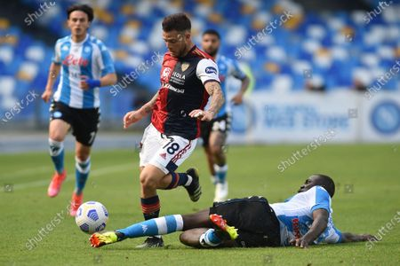 Stock Photo of Nahitan Nandez of Cagliari Calcio competes for the ball with Kalidou Koulibaly of SSC Napoli during the Serie A match between SSC Napoli and Cagliari Calcio at Stadio Diego Armando Maradona Naples Italy on 2 May 2021.