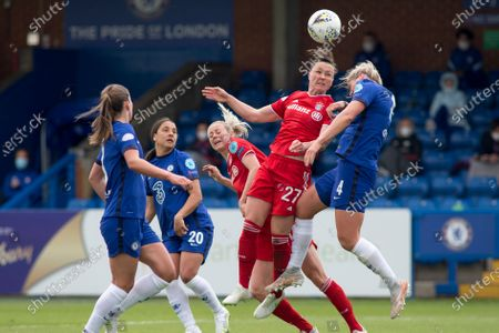 Marina Hegering (Bayern Munich) and Millie Bright (Chelsea FC) battle for the ball during the 2020-21 UEFA Women's Champions League fixture between Chelsea FC and Bayern Munich at Kingsmeadow.