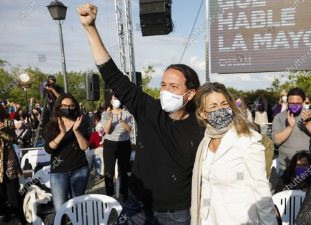 Podemos' candidate to Madrid's regional elections Pablo Iglesias (L) and Spanish Minister of Labor Yolanda Diaz attend the party's last campaign rally ahead of the regional election, in Madrid, Spain, 02 May 2021. Madrid regional elections will be held on 04 May.