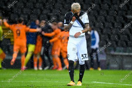 Stock Photo of Cristiano Ronaldo (Juventus) celebrates after scoring a goal 1-2 and Roberto Pereyra (Udinese) despair