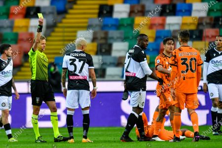 Stock Image of Chiffi section of Padova (Referee match) shows yellow card to both of Roberto Pereyra (Udinese Calcio)