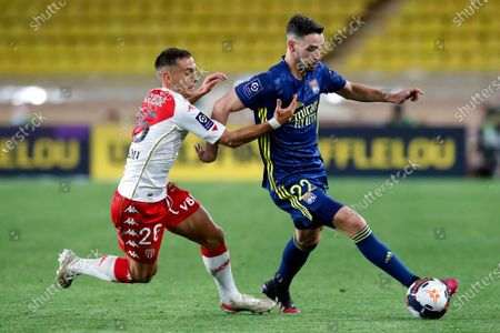 Monaco's Ruben Aguilar (L) and Lyon's Mattia De Sciglio (R) in action during the French Ligue 1 soccer match between AS Monaco and Olympique Lyonnais at the Louis II stadium in Monaco, 02 May 2021.