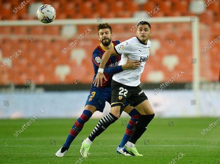 Gerard Pique of FC Barcelona and Maxi Gomez of Valencia CF