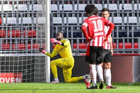 PSV goalkeeper Yvon Mvogo is disappointed by the 0-1 during the Dutch Eredivisie match between PSV Eindhoven and sc Heerenveen at the Phillips stadium